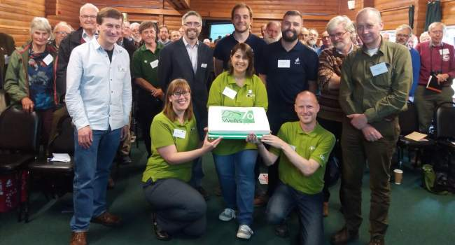 Cake and WeBS team and counters celebrating 70 years